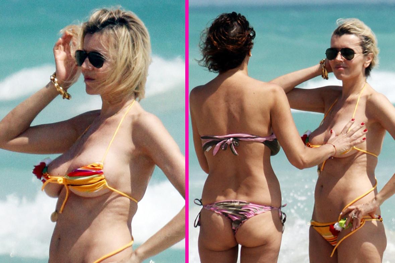 """Photo of Rita Rusic: in spiaggia a Miami, esibisce il suo topless """"esplosivo"""", contenuto a stento da un'amica"""