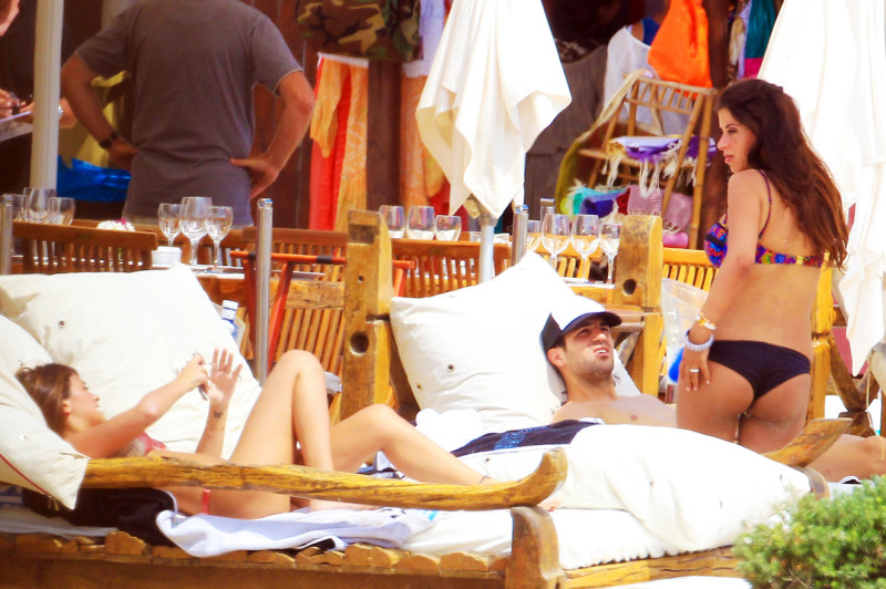 Spanish footballer & Former Arsenal captain Francesc Cesc Fabregas  relaxes on holiday with his stunning girlfriend Daniella Semaan in Ibiza