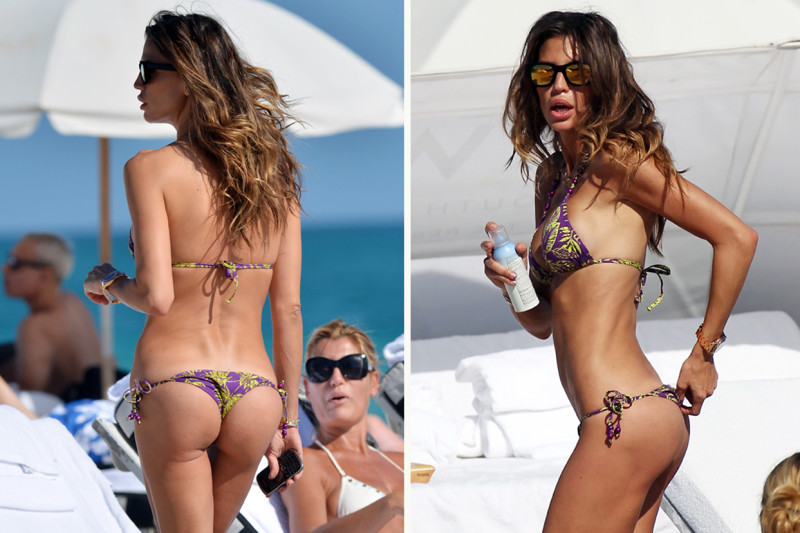 Model Claudia Galanti leaves little to the imagination with a very skimpy bikini, as she hits the beach with friends in Miami